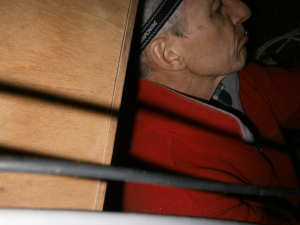 Boyd is curled up inside the electrical cupboard..