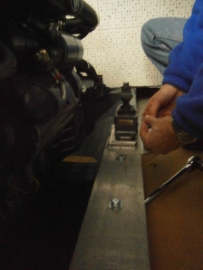 ...and another view of Boyd putting the shims under the engine mounts...