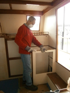 ...not only did he remove the door and hinges, but the side and top seem to have disappeared as well!